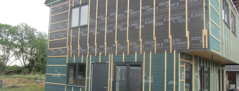 Fenêtre sur maison ossature bois avec isolation par l'extérieur