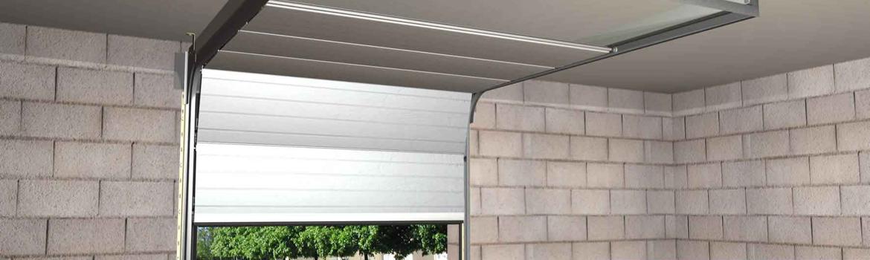 Installation d'une motorisation sur une porte de garage sectionnelle