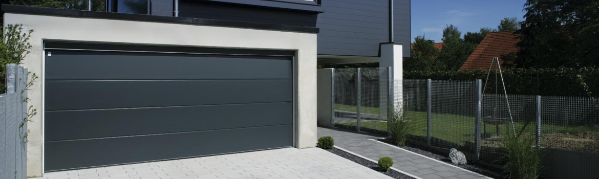 R glage d une porte de garage sectionnelle for Grande porte de garage sectionnelle
