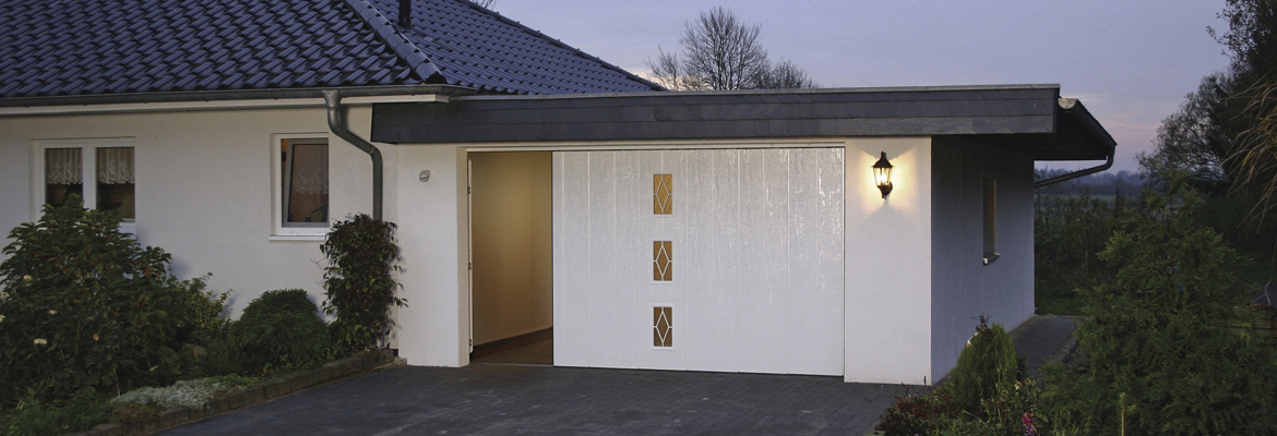 Porte de garage sectionnelle sans rail au plafond for Hublot porte garage sectionnelle