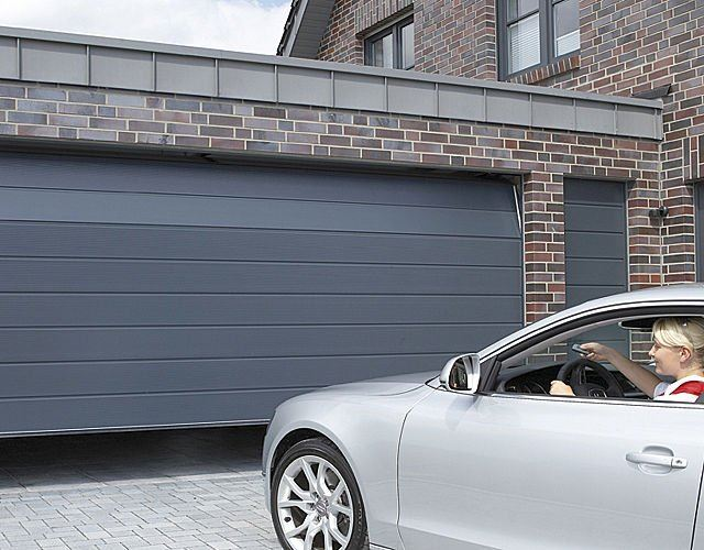Porte de garage motoris e porte de garage lectrique somfy - Motorisation porte de garage sectionnelle somfy ...
